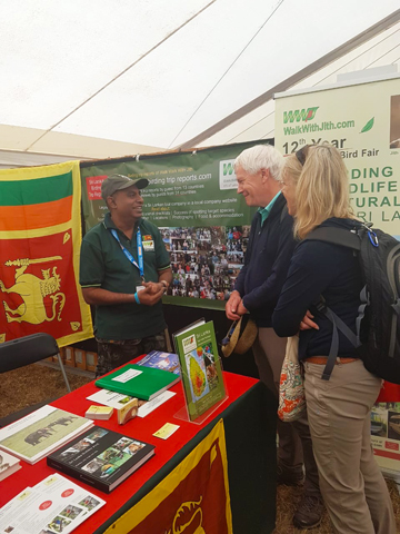 Jith talking to two guests British Bird Fair